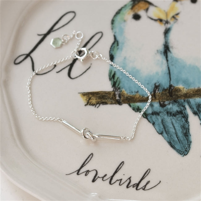 Friendship Knot Sterling Silver Bracelet Showcased On A Lovebird Plate