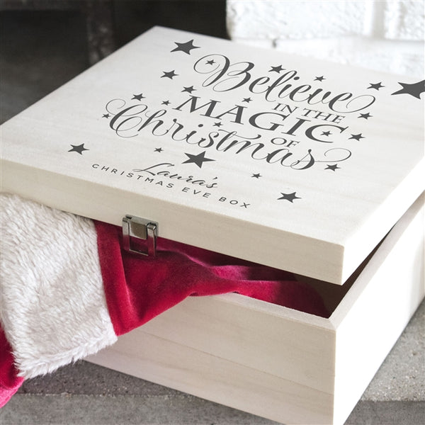 "A Beautiful Wooden Believe Christmas Eve Box With Text That Reads ""Believe In The Magic Of Christmas"" Engulfed In Stars"