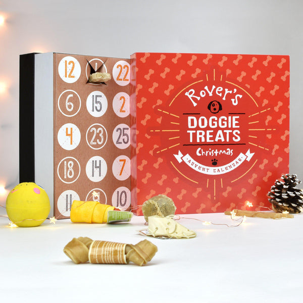 Personalised Dog Treats Advent Box - Dog Treats Lying In Front Of The Personalised Red Dog Advent Calendar