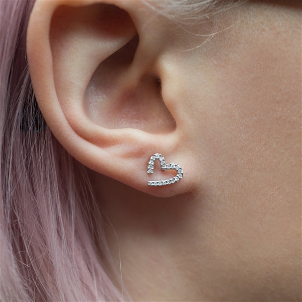 Modern White Gold Diamond Heart Earrings Being Worn By A Model
