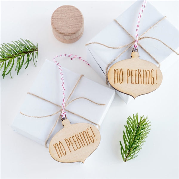 No Peeking Bauble wooden cut out Gift tags in a bauble design engraved with 'No Peeking!'. Supplied hanging from red & white baker's twine