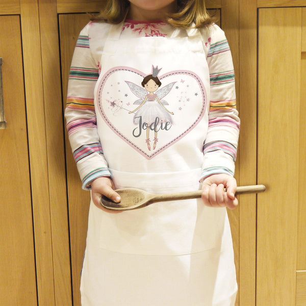 Personalised Fairy Princess Children's Apron - Modelled By A Young Child Who I Ready To Bake