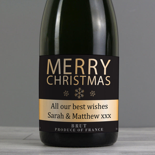 Personalised Merry Christmas Champagne - Close Up Of Label That Features Gold Snow Flakes