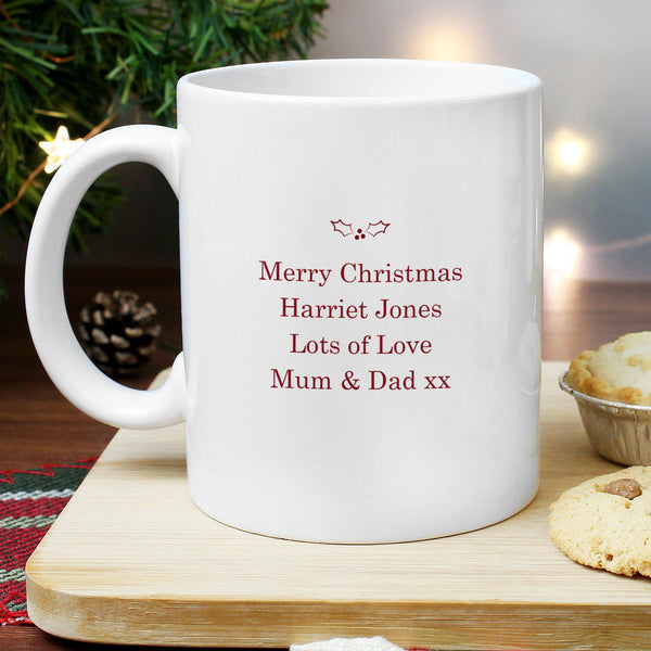 Personalised Merry Little Christmas Mug - Close Up Of The Rear Personalised Red Text Below Some Holly
