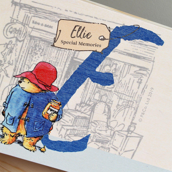 Paddington Bear Initial Memory Box - Lid Featuring Paddington Holding His Honey Standing By The Initial E With A Tag Hanging Off The Initial Featuring Ellie Above Special Memories Wording