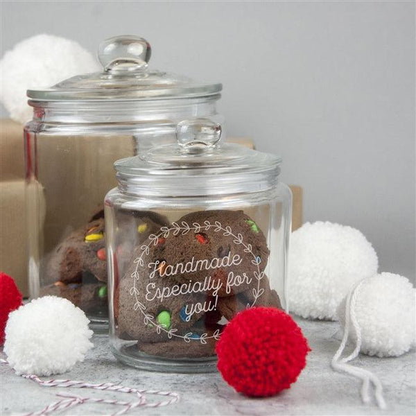 A sturdy glass Christmas jar with rubber seal on the push on lid, personalise text inside a festive wreath designythinguneed