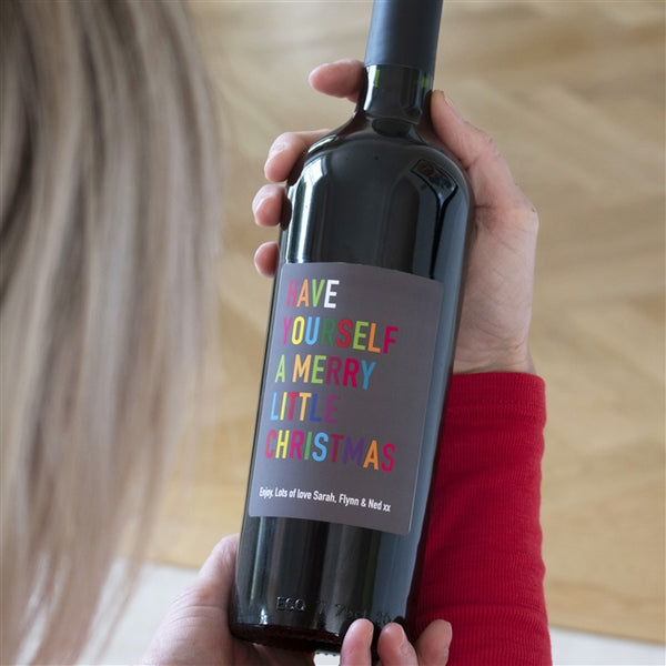 "Personalised Merry Little Christmas Red Wine With Multi coloured Text That Reads ""Have Yourself A Merry Little Christmas"""