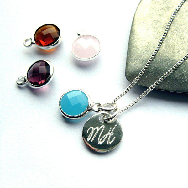 Necklace With Light Blue (Mar) Birthstone And Initials On A SS Disc, Birthstones Dark Red (Jan), Purple (Feb) And Light Pink (Oct) Sit By The Necklace