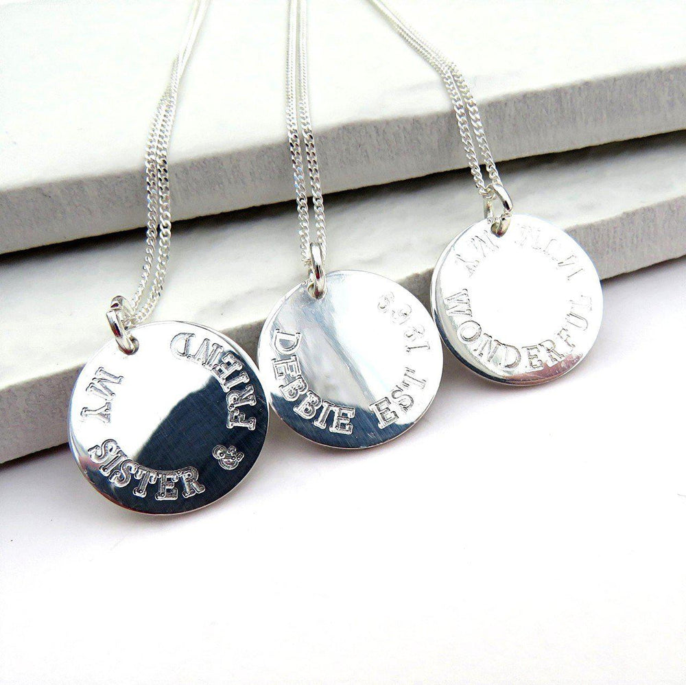Personalised Sterling Silver Round Charm Necklaces Which Are All Engraved With A Special Message