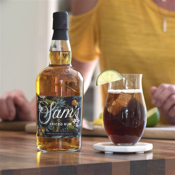 Personalised bottle of spiced rum with an on-trend tropical label. The label is printed with any name and your own message along the lower edge.