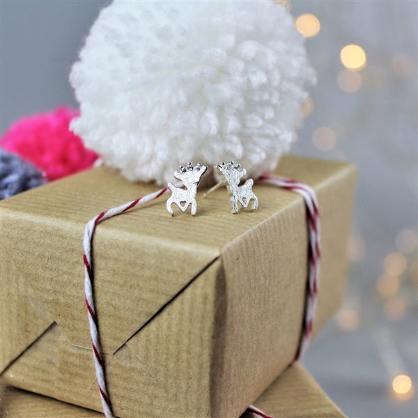 Sterling Silver Reindeer Earrings Standing On Top Of Presents