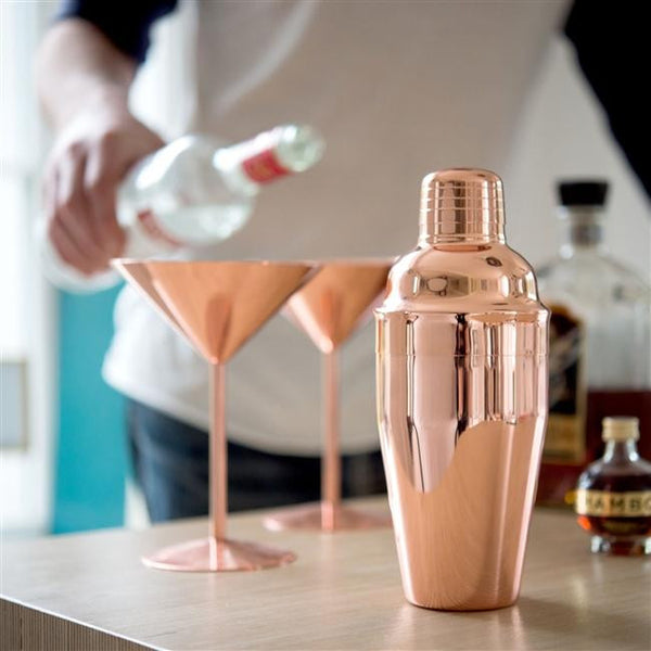 Rose Copper Cocktail Shaker With Copper Glasses And Drinks In The Background