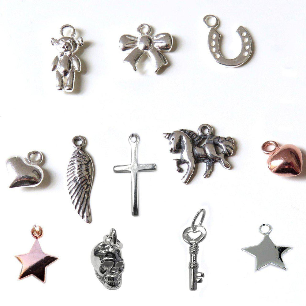 Charms In The Picture Are Teddy, Bow, Horseshoe,, Silver Heart, Angel Wing, Cross, Unicorn, Gold Heart, Gold Star, Skull, Key And Silver Star
