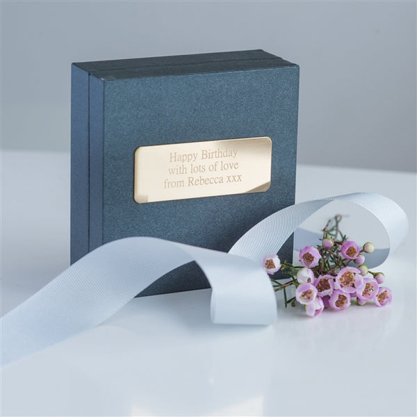 Presented in a high quality grey gift box hand-tied with a light-grey grosgrain ribbon. The box is personalised with an engraved gold nameplate