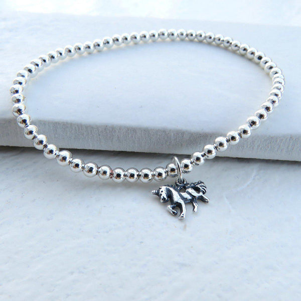 Silver Beaded Charm Bracelet With A Cute Unicorn Charm Attached