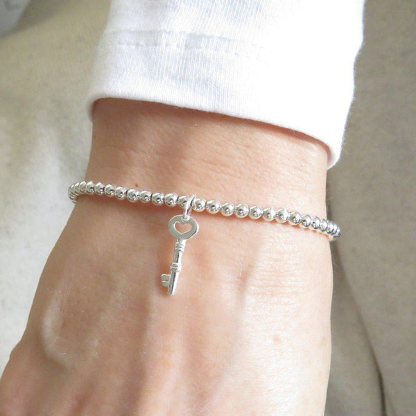 Silver Beaded Charm Bracelet - Model Is Showing Off The Key Charm And Bracelet