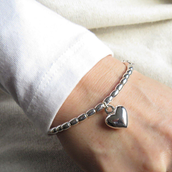 Silver Beaded Stretch Bracelet With A Heart Charm