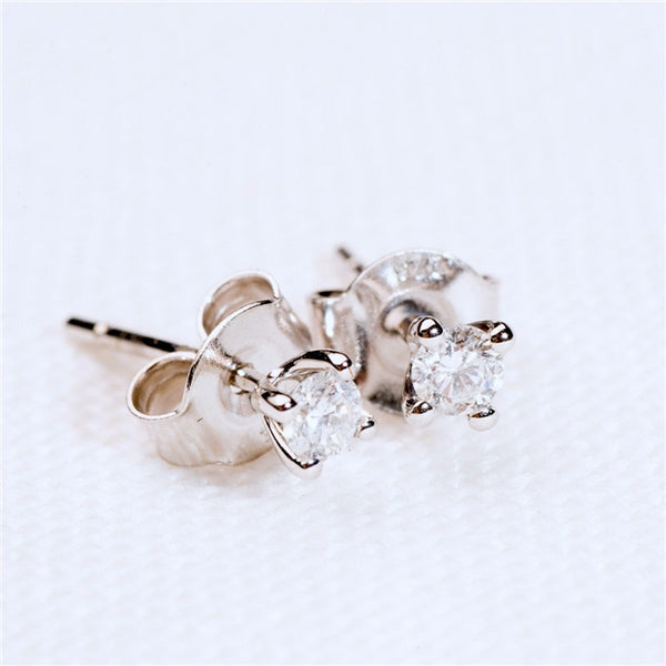 Stunning solitaire diamond stud earrings. Brilliant cut diamonds set in 9K white gold