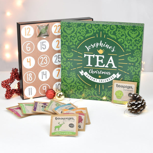 Personalised Tea Advent Box - A Selection Of Teapigs Tea Bags Laid Out In Front Of The Open Advent Calendar
