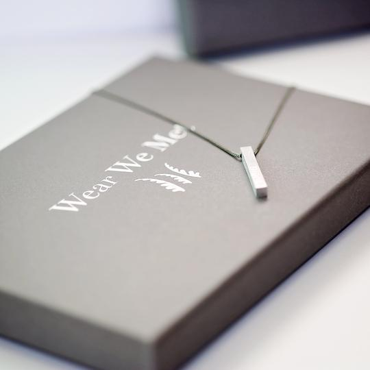 Picture of the brushed necklace on a beautiful gift box