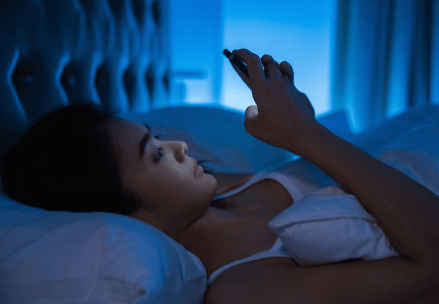 What being on your phone in bed does to your skin