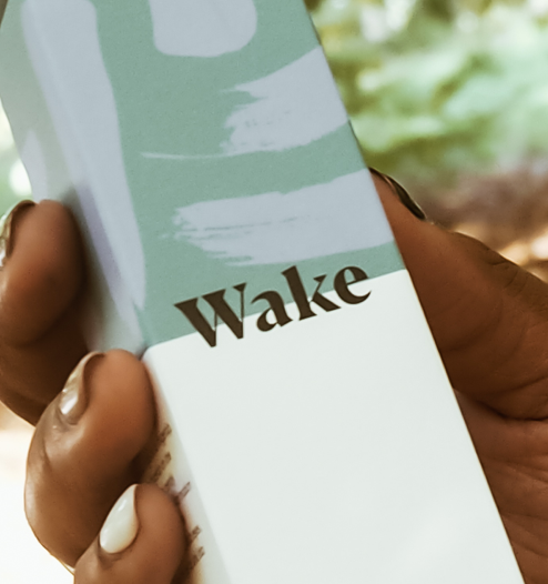 woman holding wake eye gel