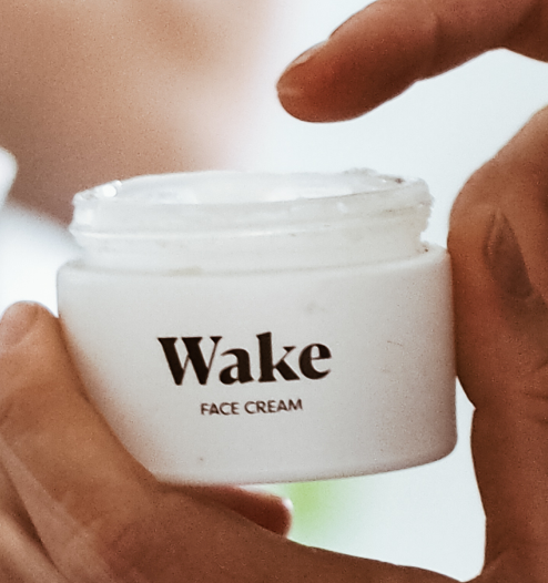 wake face cream being applied