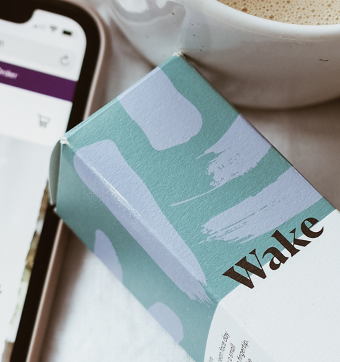 wake eye gel next to mobile phone