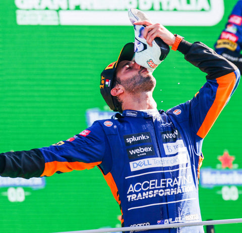 Racer drinks champagne from shoe