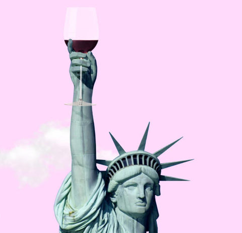 statue of liberty holding glass of wine photo