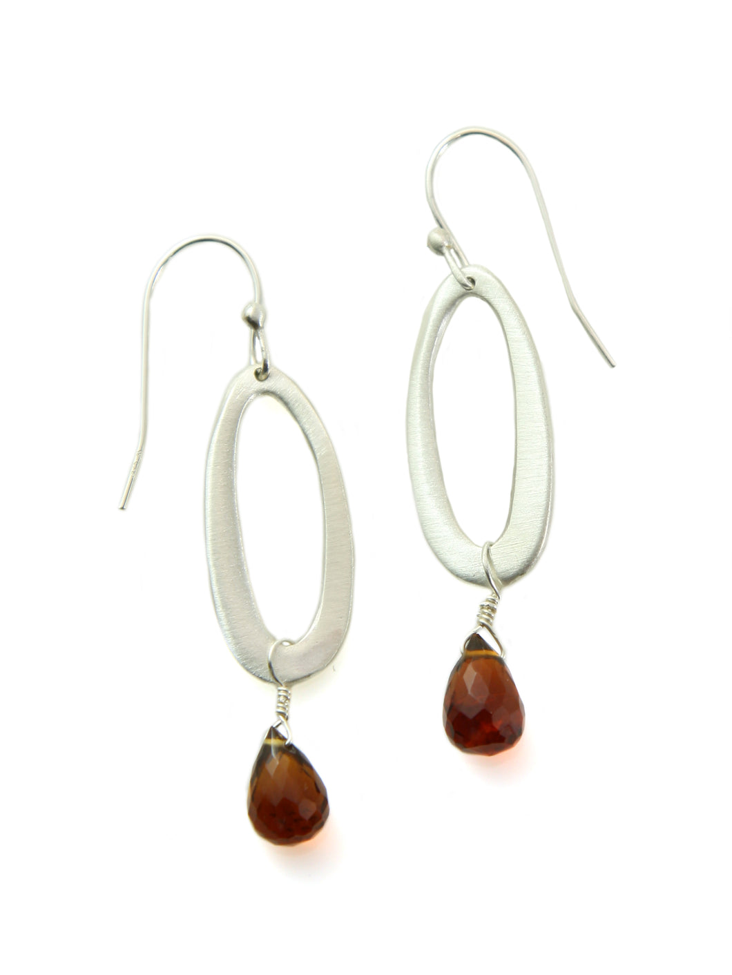 Philippa Roberts: Small oval w. garnet. silver earrings