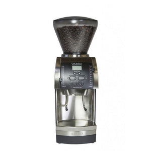 Front view of a black and silver Baratza Vario coffee grinder with beans in the clear funnel on top.