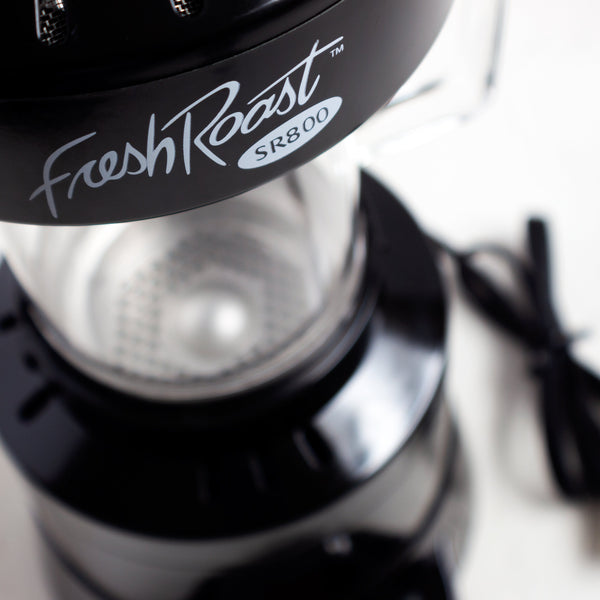Overhead close up of the Fresh Roast SR800 logo and the roaster itself.