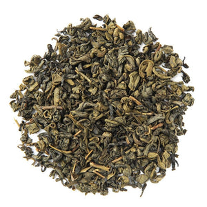 A pile of Organic Pinhead Gunpowder Tea.