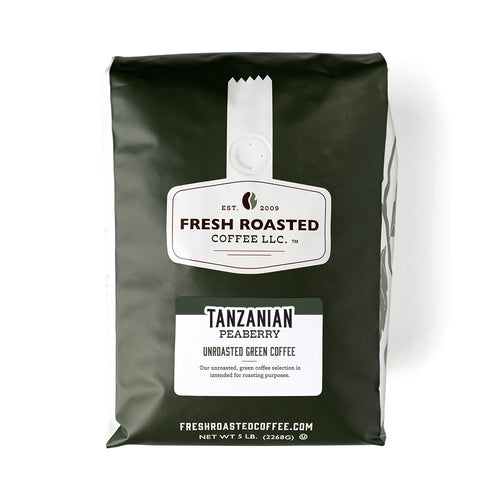 A green bag of unroasted Tanzanian Peaberry coffee.
