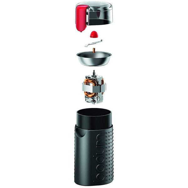 The components of a Bodum Bistro Electric Blade Coffee Grinder, including the blade, bowl, and inner mechanism.