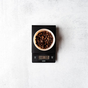 Overhead view of Hario V60 Drip Scale and Timer with a bowl of coffee beans on top.