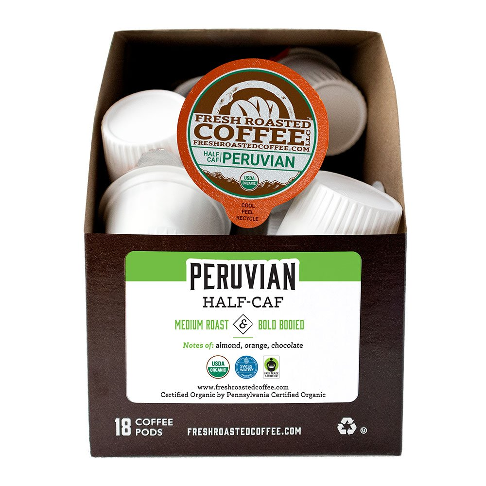 A box of Organic Swiss Water Half Caf Peruvian single serve coffee pods.