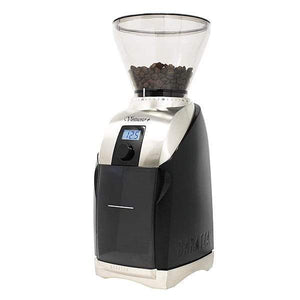 Black and silver Baratza Virtuoso+ coffee grinder with beans in the clear funnel on top.