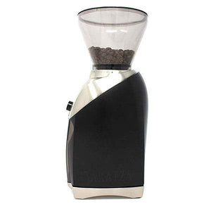Side view of a black and silver Baratza Virtuoso+ coffee grinder with beans in the clear funnel on top.