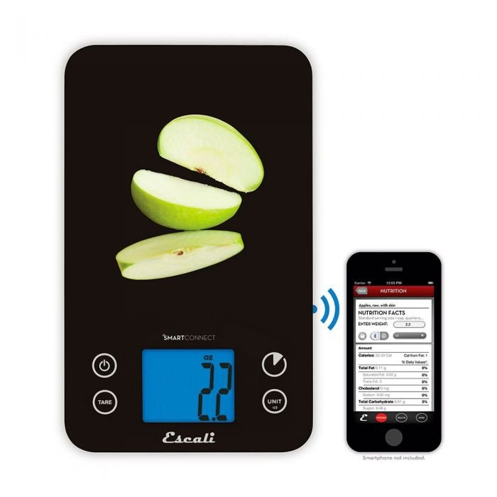 Overhead view of a black Escali SmartConnect Digital Kitchen Scale with apple slices on top, next to a phone displaying nutritional facts.