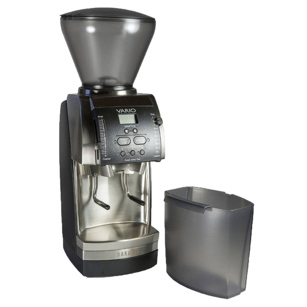 Black and silver Baratza Vario coffee grinder next to a partially clear, grey container.
