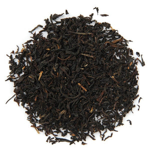 Pile of Organic Assam TGFOP Black Tea.
