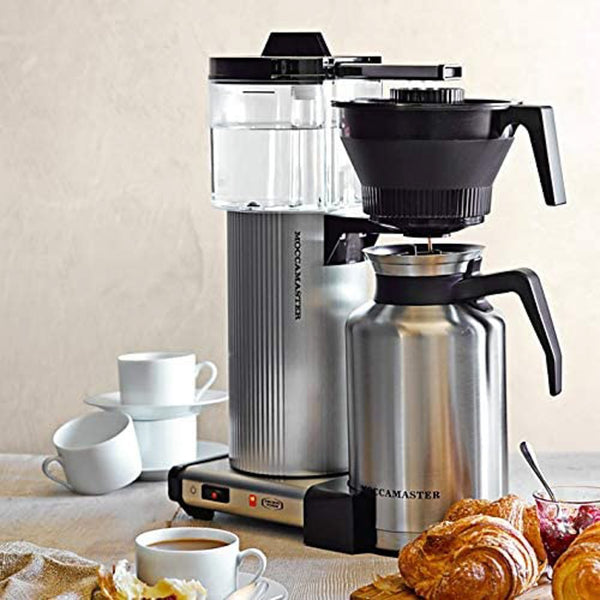 Technivorm Moccamaster CDT Grand with Brushed Silver Carafe, cofee mugs, and croissants.