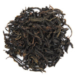 A pile of Organic Qilan Wuyuan Oolong Tea.