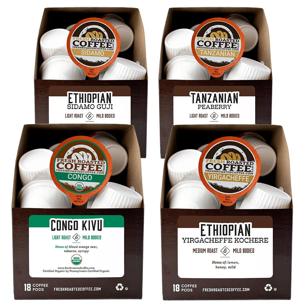 Four boxes of single-serve coffee pods from the African Coffee Pod Variety Pack: Ethiopian Sidamo Guji, Tanzanian Peaberry, Organic Congo Kivu, and Ethiopian Yirgacheffe Kochere.