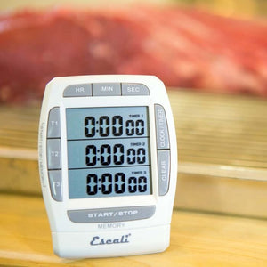Escali Triple Event Digital Timer on a kitchen table.