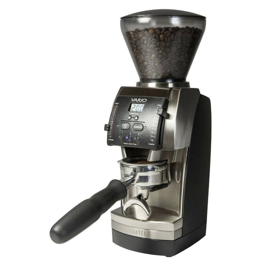 Black and silver Baratza Vario coffee grinder with beans in the clear funnel on top.