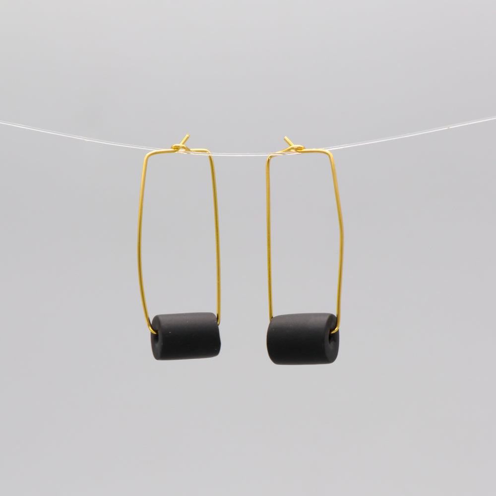 Gold rectangular earrings with a black bead