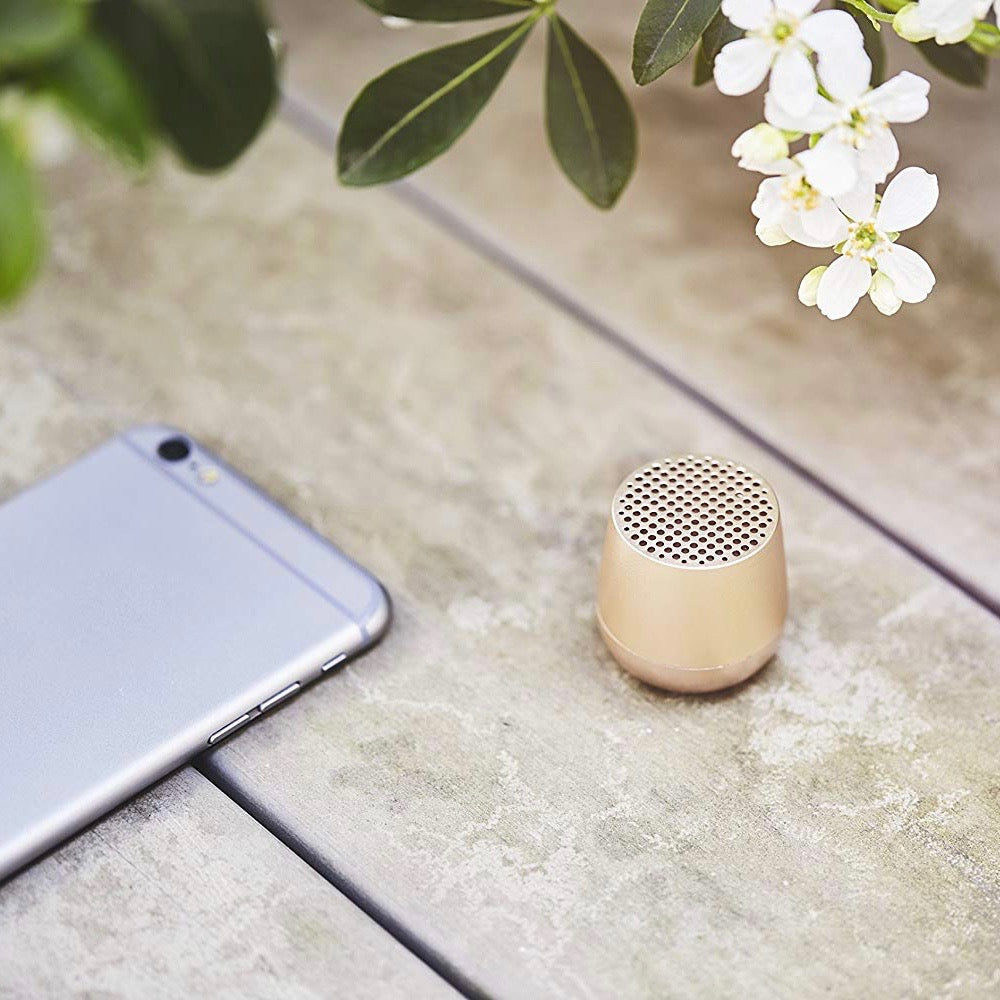 Ultra-portable bluetooth speaker in light gold